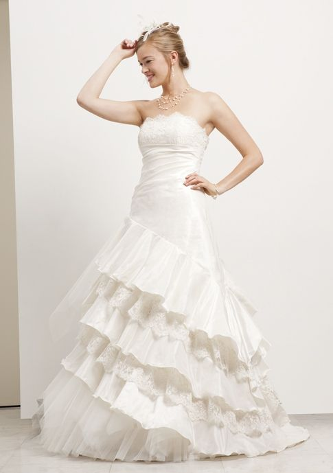 Ivory a-line strapless wedding dress with ruffle and lace details on skirt