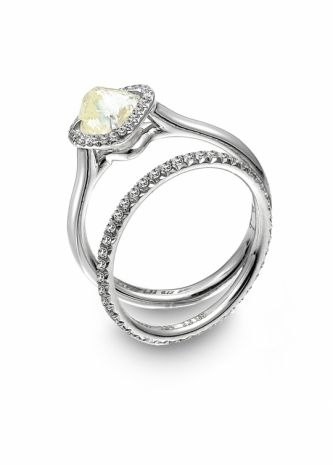 and gorgeous platinum engagement ring with natural uncut yellow diamond