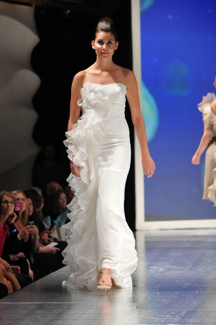 White strapless mermaid wedding dress with ruffle detail