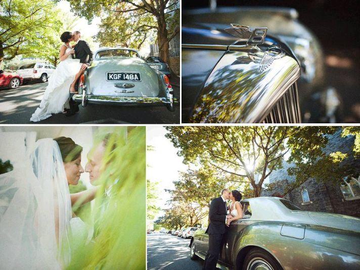 Bride and groom have fun in front of vintage wedding day ride- a silver Bentley