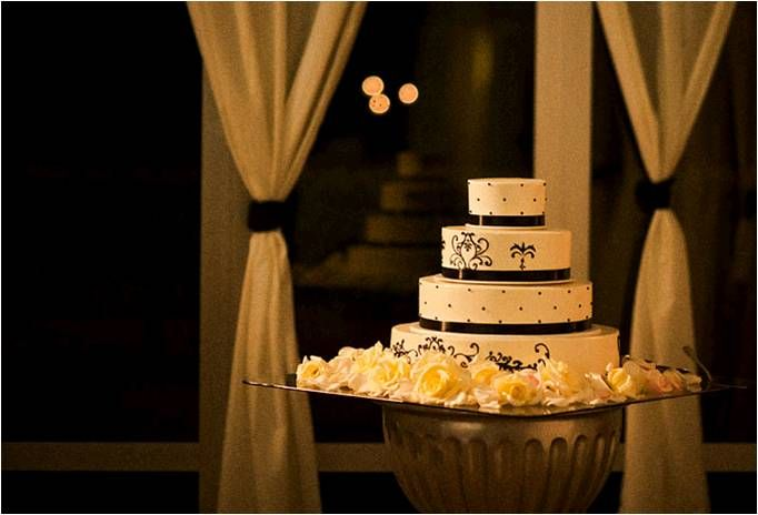 Classic 4tier white wedding cake with black scroll pattern