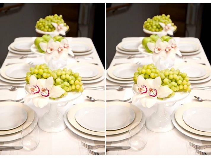 Unique wedding centerpiece idea- fruit & orchids on wedding cake stand