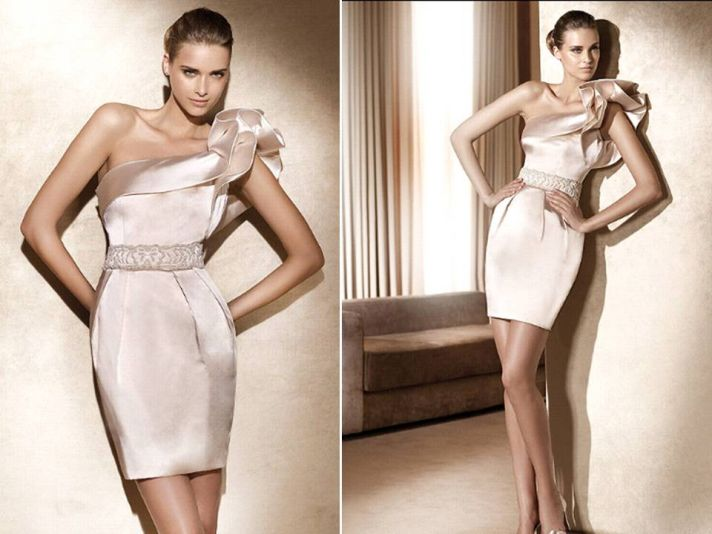 Silk champagne one-shoulder wedding reception dress with ruffle detail on sleeve