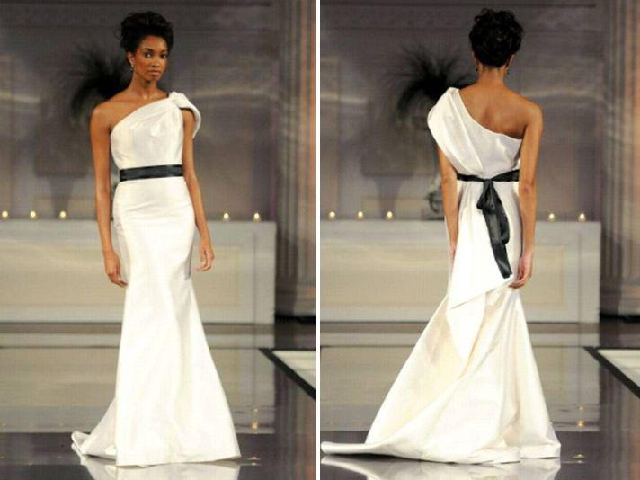 One-shoulder ivory mermaid wedding dress with black bridal sash