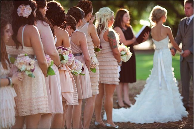 Casual outdoor wedding with mix and match peach and beige bridesmaids' dresses