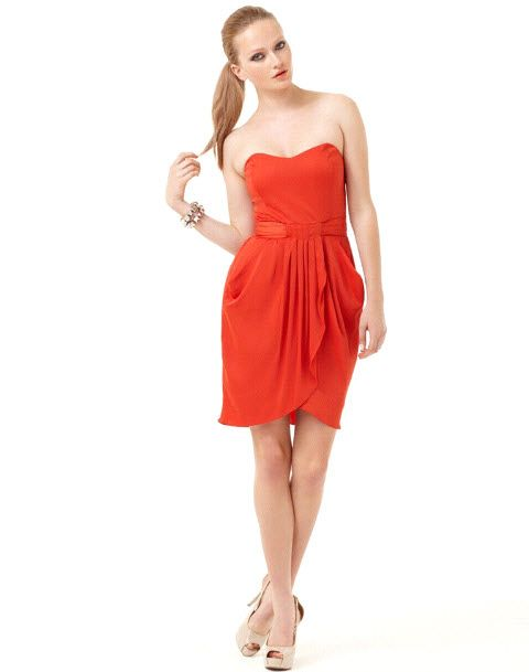 Burnt orange strapless bridesmaid dress with sash and draping
