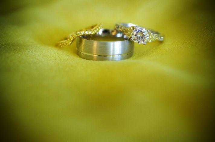 Round diamond engagement ring and groom's wedding band
