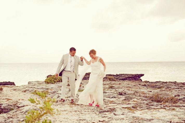 Beach bride and groom take romantic photos near the ocean