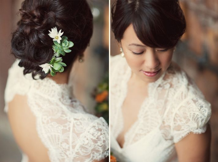Gorgeous bride wears lace wedding dress and succulents in hair