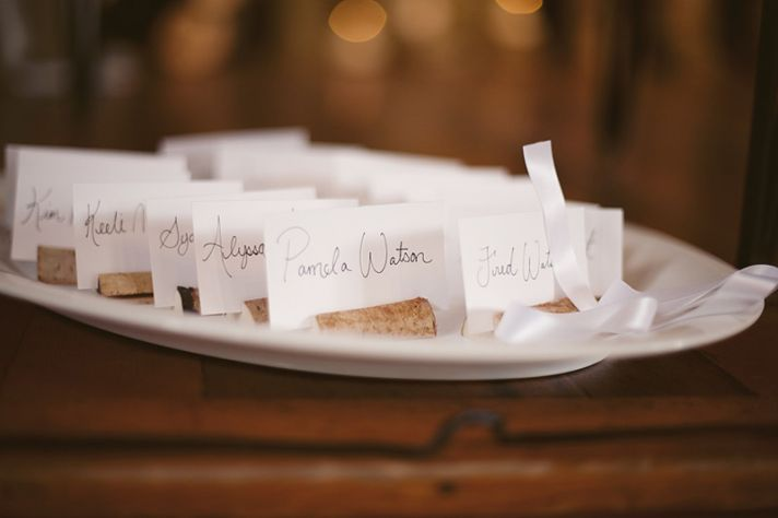 DIY wedding reception escort cards in white with black calligraphy