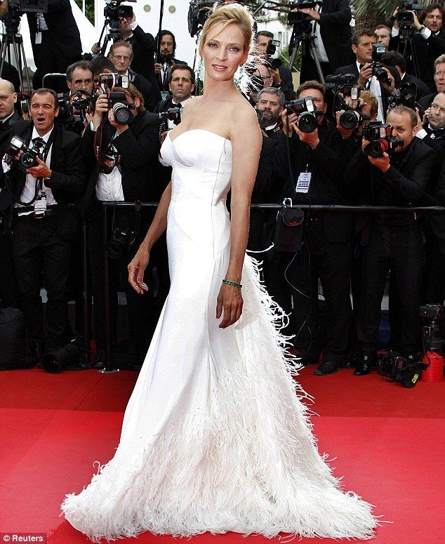 White a-line sweetheart custom Versace with feather-adorned skirt at Cannes 2011