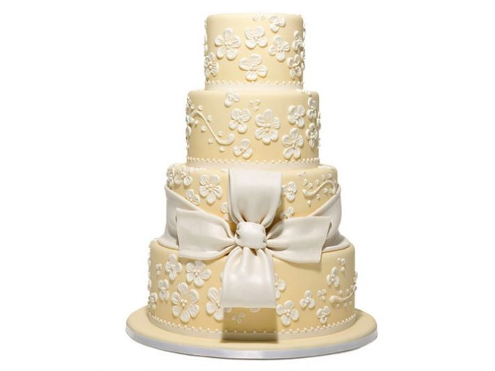 ELegant buttery yellow and pearl ivory floral-adorned wedding cake