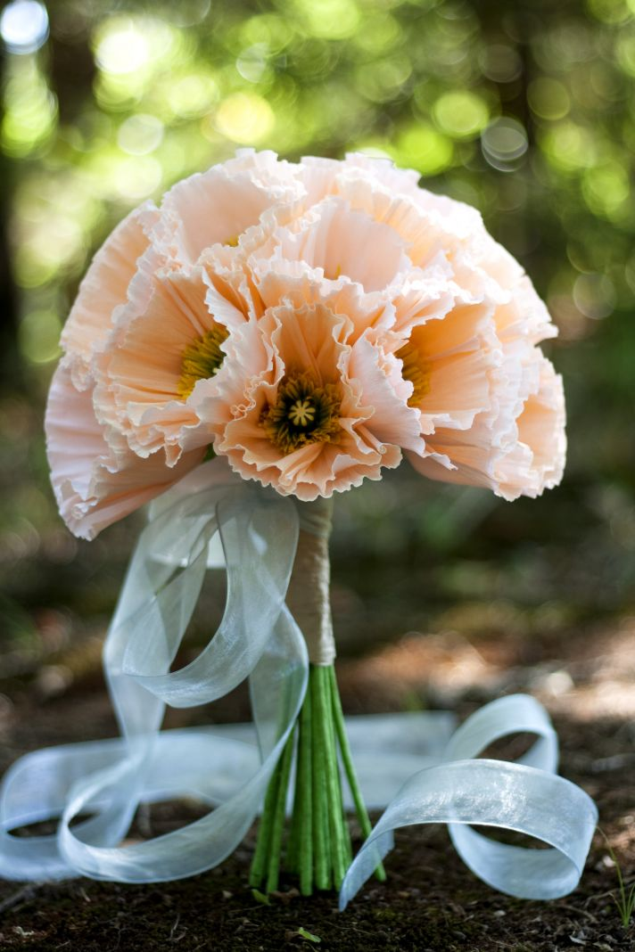 Handmade paper flowers bridal bouquet in romantic peach tied with sage green ribbon