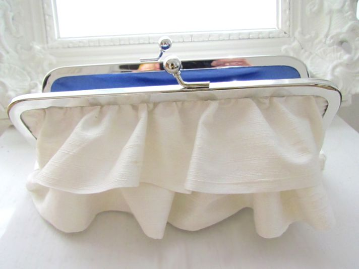Ivory bridal clutch with elegant ruffles and something blue silk inside