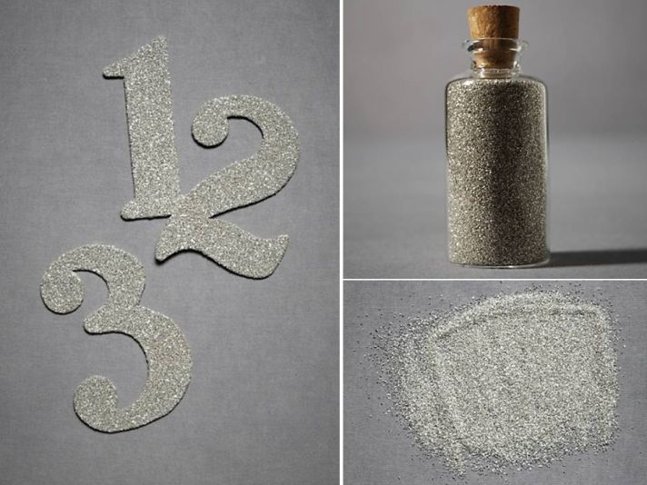 Sparkly silver metallic wedding reception table numbers and sparkly sand