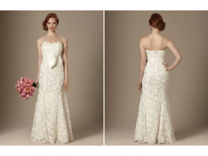 Romantic ivory strapless modified a-line wedding dress embellished with lace and beading