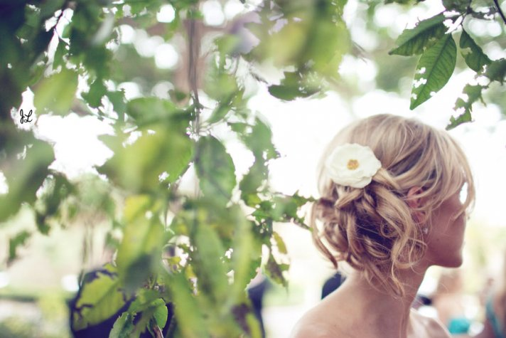 Summer wedding hairstyle- soft chignon with braid and flower