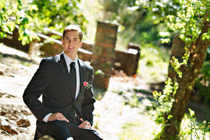 Modern black suit for your dapper groom