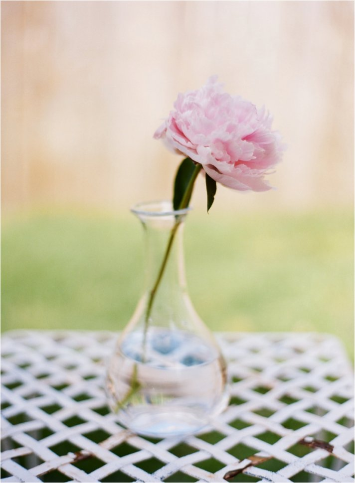 Simple single peony wedding reception centerpiece