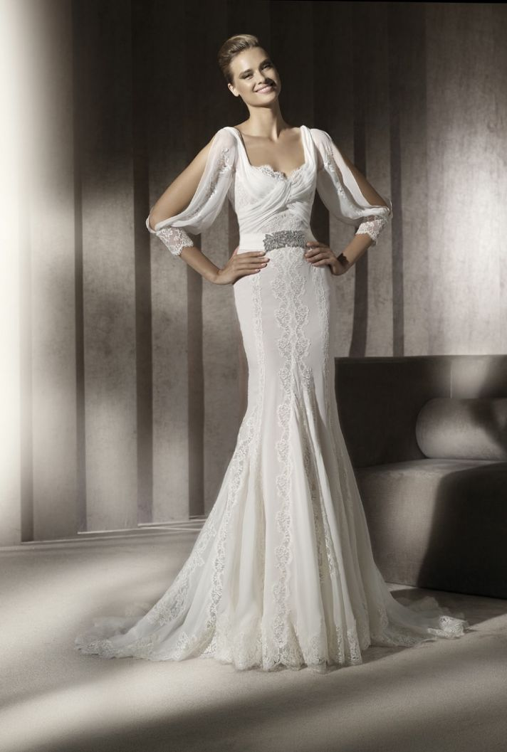 Lace mermaid wedding dress with sleeves and embellished bridal belt