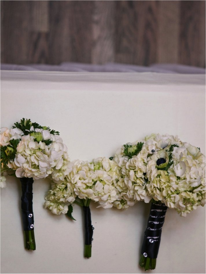 Bridal bouquet of ivory anemones, tied with black satin ribbon