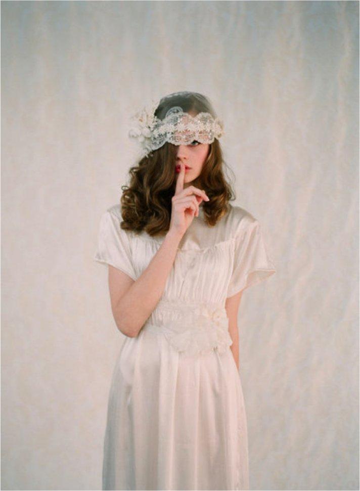 Vintage bride wears lace bridal cap, sheath wedding dress