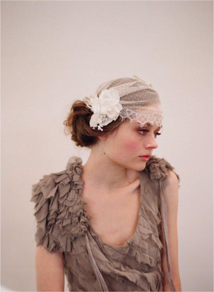 Romantic ivory lace bridal cap with vintage flower accent