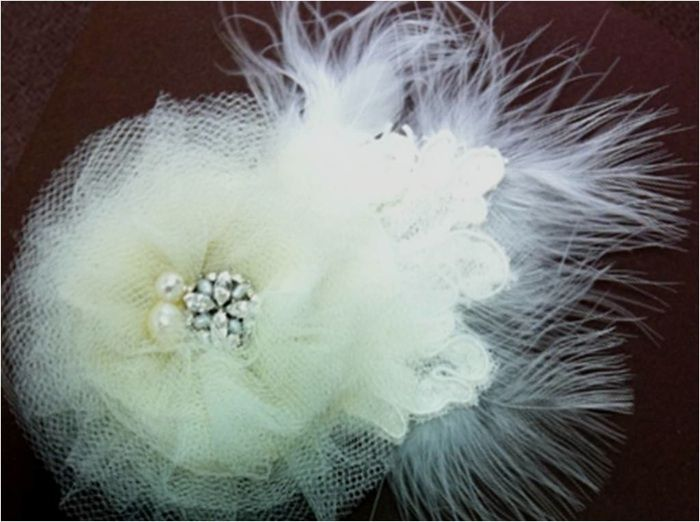 Bridal fascinator embellished with vintage brooch and feathers