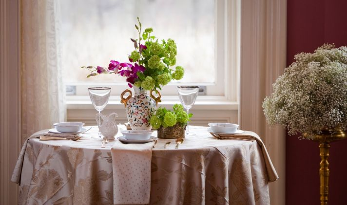 Antique-inspired wedding reception tabletop decor and wedding flower centerpieces