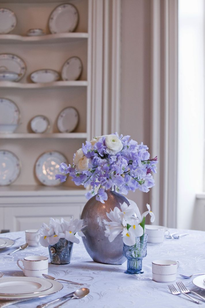 Antique China, lilac and ivory wedding flowers, elegant wedding reception venue