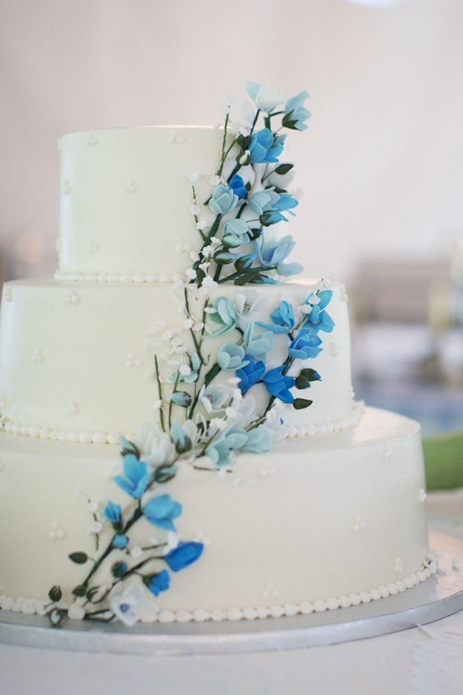 Classic white wedding cake with blooming branches design