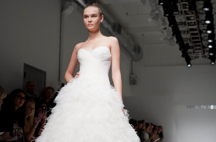 Modern feather-adorned ballgown wedding dress