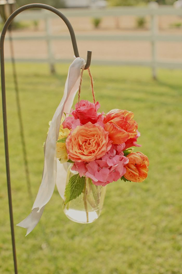 Bright orange and pink wedding reception centerpieces