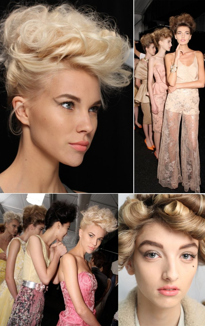 Voluminous bridal hairstyle and dramatic wedding makeup