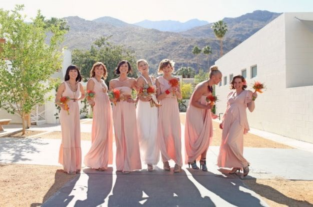 Outdoor beach wedding with mix and match bridesmaids dresses