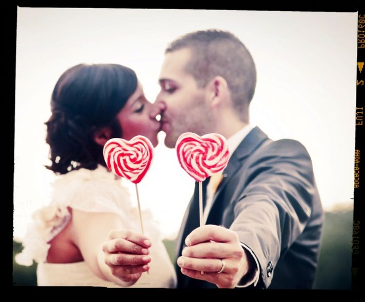 Retro bride kisses groom