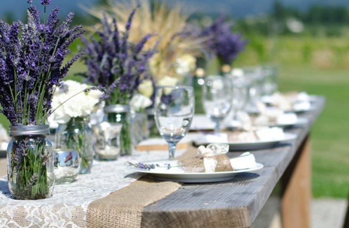 outdoor wedding reception centerpieces mason jars purple wedding flowers