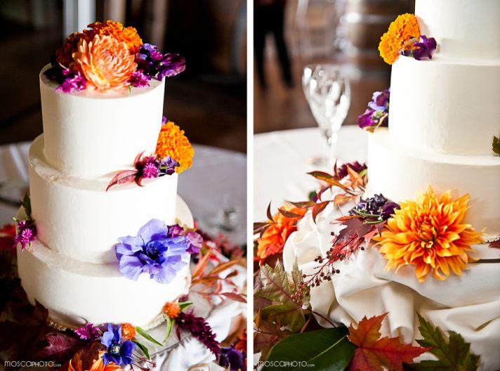 white wedding cake colorful flowers