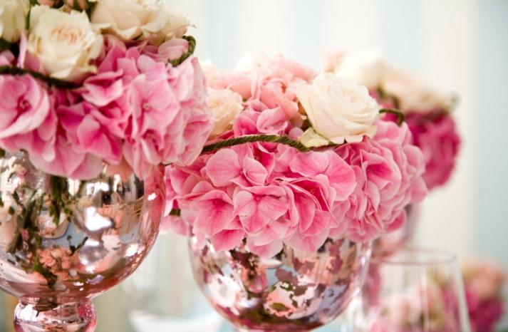 wedding detail shot pink wedding flower centerpieces