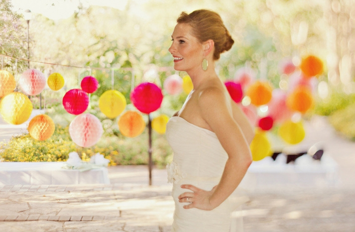 bride wears chic chignon outdoor wedding colorful