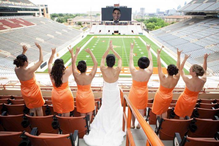 sports themed wedding bridesmaids wear orange bride wearing white wedding dress