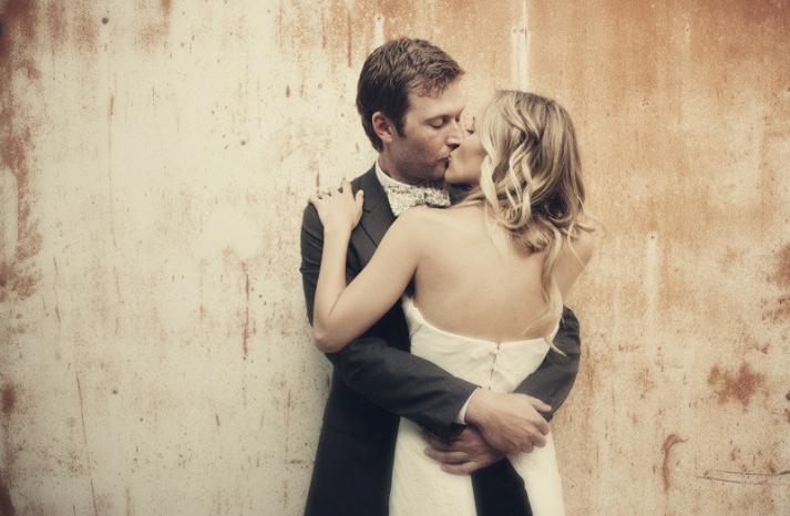 all down wedding hair loose waves bride groom kiss