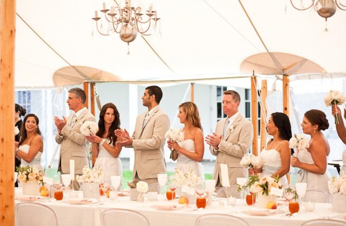 elegant real wedding outdoor reception under tent chandeliers above