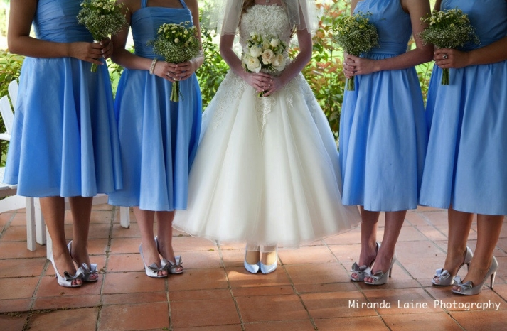 secret garden wedding inspiration blue bridesmaids dresses tea length wedding dress