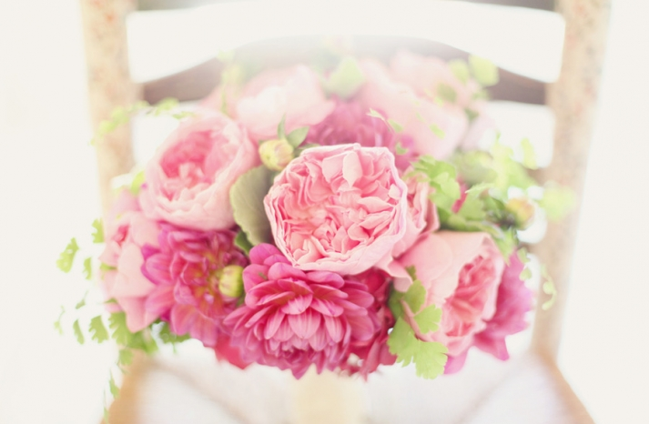 romantic pink bridal bouquet peonies sits on chair