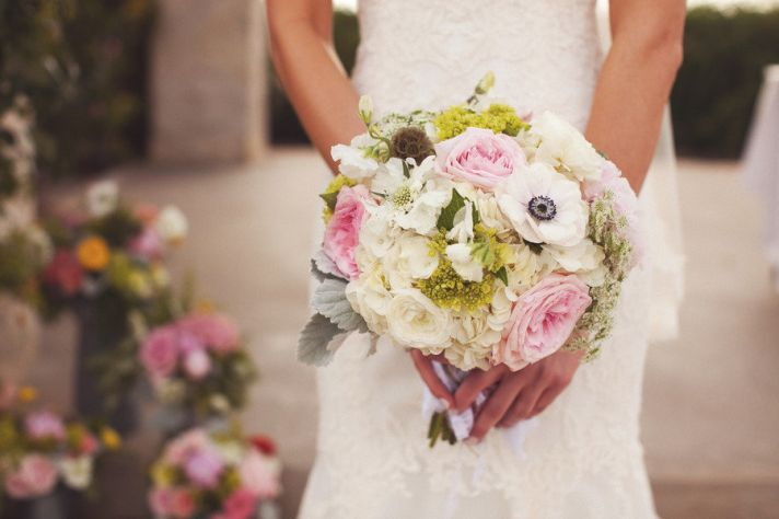 favorite bridal bouquets for spring light pink ivory roses anemones green