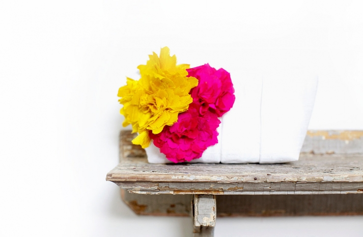 hot pink yellow wedding flowers adorn white bridal clutch