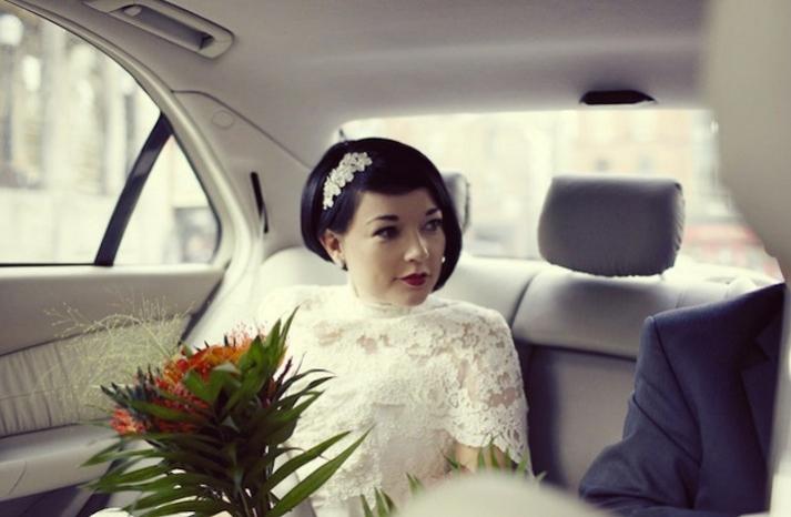 short wedding hair bride wears lace wedding cape