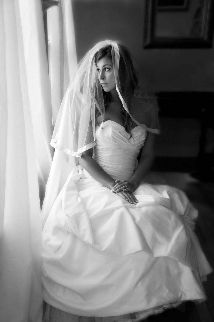 classic bride wears white wedding dress tiered bridal veil