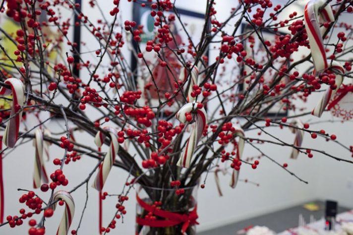 winter wedding centerpiece manzanita branches red berries candy canes